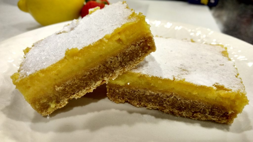 Now you've just got to sprinkle the Lemon Bars with powdered sugar and you're good to go.