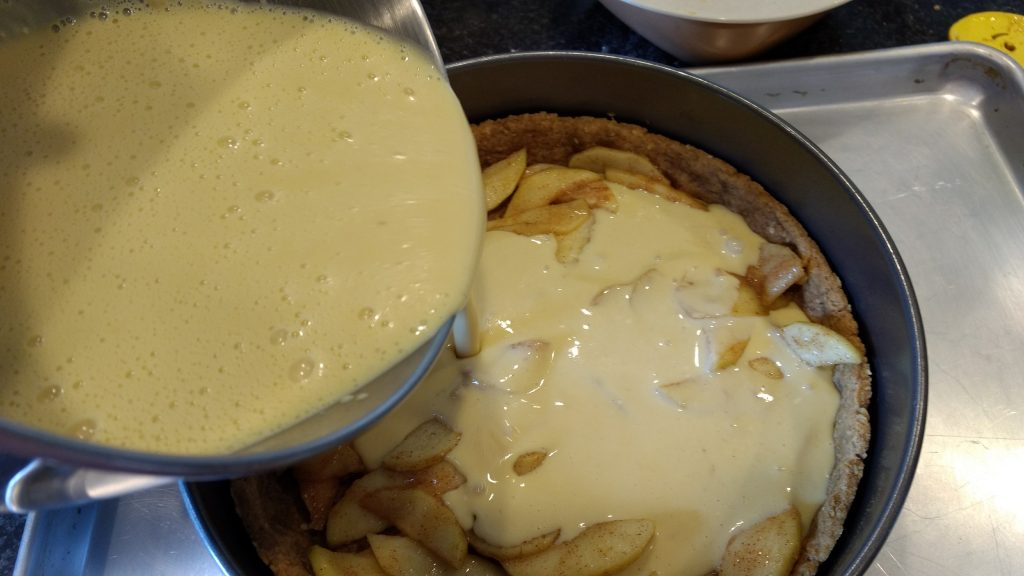 adding custard to pie filling